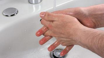 Unrecognisable person washing hands photo