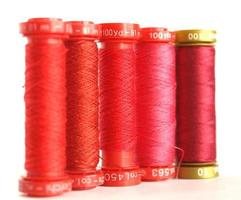 Red sewing spools photo