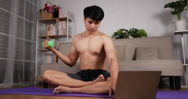 Man Using Laptop and Doing Dumbbells video