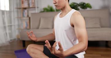 Closeup of Man Doing Yoga Meditation Indoors video