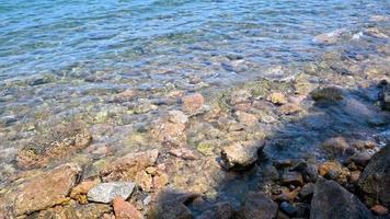 Beach with stones by the sea in Porto Santo Stefano video