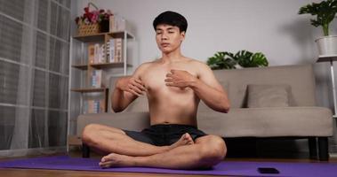 Man Doing Yoga Meditation Indoors video