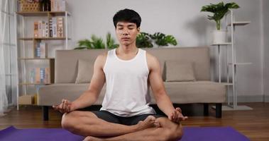 Man Engaging in Yoga Meditation Indoors video