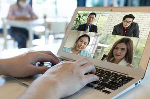 woman video call with clients during covid 19  outbreak photo