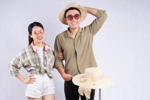 Young Asian couple posing on white background photo