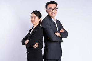 Asian businessman and businesswoman posing on white background photo