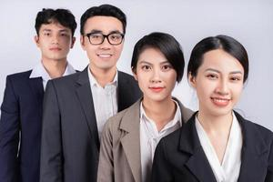 Group of Asian business people posing on a white background photo