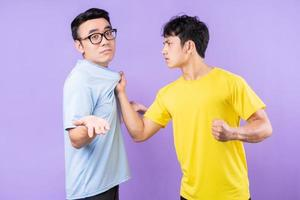 Two Asian brothers arguing with each other photo