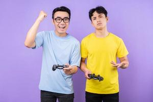 Two Asian brothers playing games together photo