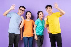 Asian best friends posing on purple background photo
