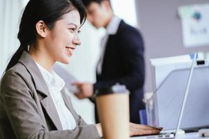 Portrait of Asian businesswoman smiling with confidence photo