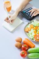 Young Asian woman with healthy meals photo