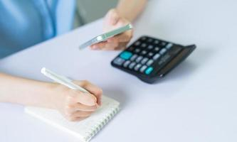 Asian woman is calculating personal income tax to pay photo