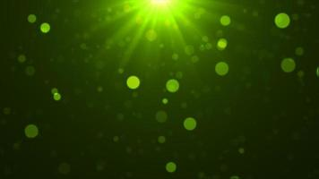 Green falling glowing particles background photo
