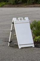 Empty white sign board on the road photo
