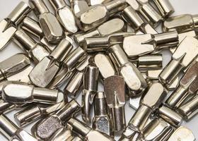 Close up shot of pile of shelf pins photo