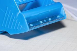 Close up shot of cutting edge of tape dispenser photo