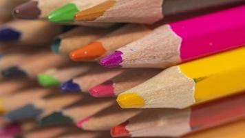 Close up shot of colorful pencils stack photo