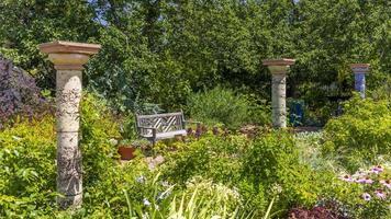 Relaxing bench in famous Denver Botanical gardens photo