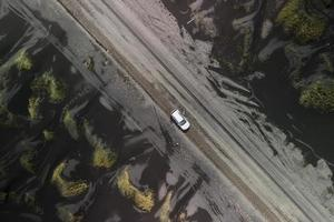 Aerial view of  black sand dunes near Vestrahorn in Iceland photo