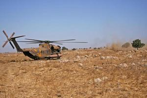 City, Country, MMM DD, YYYY - Military rescue helicopter photo