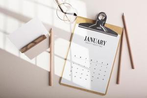 Top view arrangement with calendar pencils photo