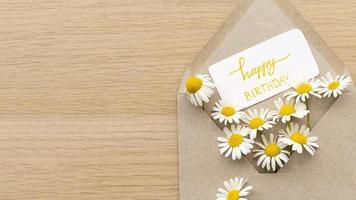 Top view birthday flowers envelope photo