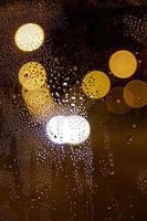 las luces nocturnas borrosas vista nocturna de la ciudad foto