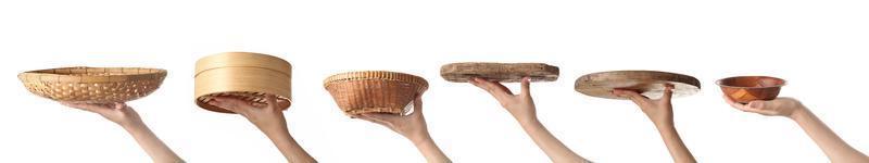 Female hand holding wooden utensil on white background photo