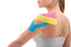 dynamic functional bandage with taping on female shouder isolated photo