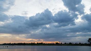 Storm Cloud over the River at Sunset Time lapse video