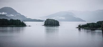 Alaska nature and mountain range with seascape in June photo