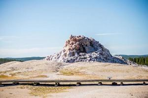Tall geyser butte at Yellowstone National Park in Wyoming photo