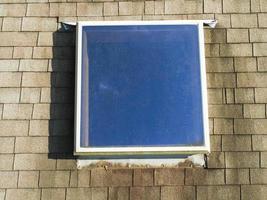 Home shingle roof with skylight photo