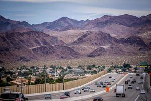 Las Vegas city surrounded by Red Rock mountains and Valley of Fire photo