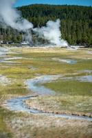 Eruption of Old Faithful geyser at Yellowstone National park photo