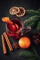 Warm Christmas drink with spices and fruits photo