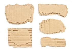 Corrugated torn cardboard paper isolated on white background photo