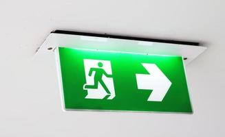 Emergency exit sign in the building photo