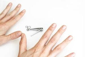 Trimmed nails of a young man photo