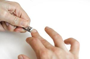 A young man does a manicure photo