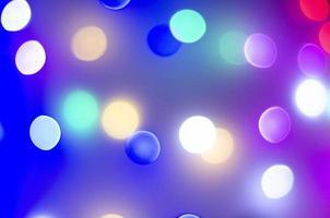 Bokeh multicolor en colores neón. foto