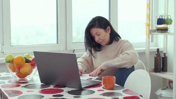 adult business woman typing on laptop computer working in internet, female professional user lady using pc technology doing online job in office or browsing web sit at home photo