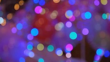 Shimmering abstract colored circles defocused christmas lights video. Blurred fairy lights. Out of focus holiday background christmas tree. Light bokeh from Xmas tree. photo