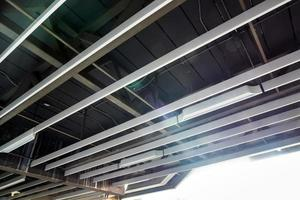 Ceiling mounted ducts of electric power and communication system photo
