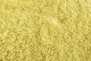 Yellow Fur of fabric surface texture photo
