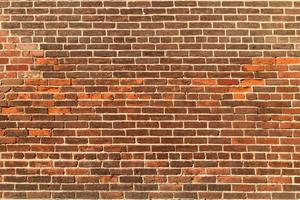 Red brick wall texture background. photo