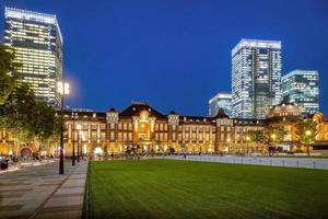 Tokyo railway station and Tokyo modern high rise building photo