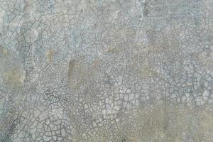 Grunge bare cracked concrete wall texture background. photo