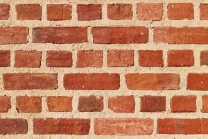 Closed up orange brick wall texture. photo